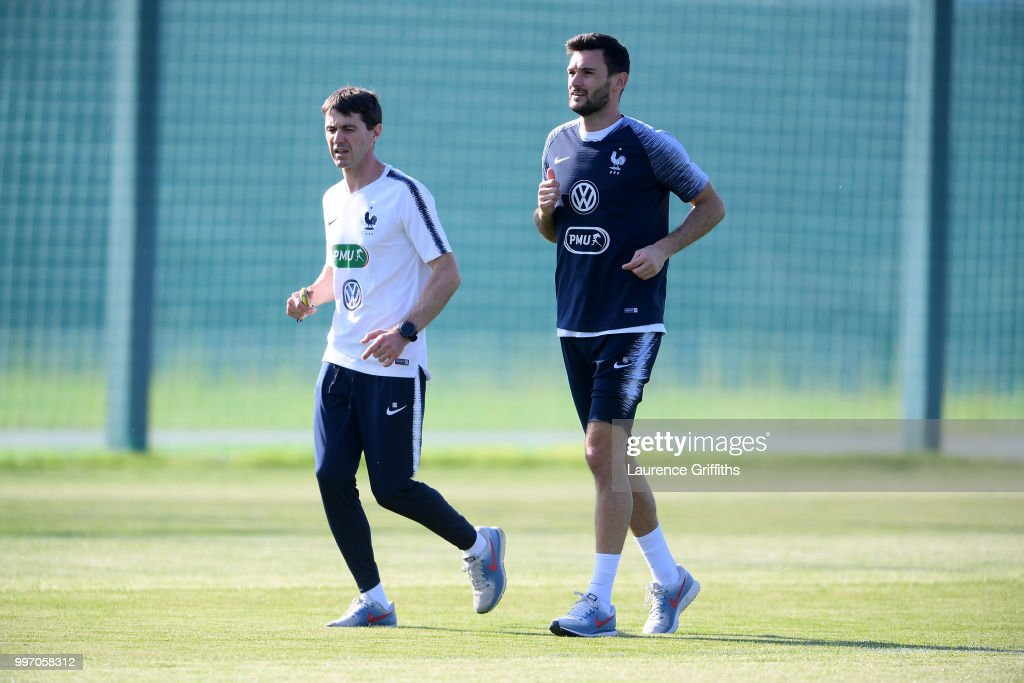 Physical trainser Gregory Dupont and Hugo Lloris warm up during a France trainig session on July 12, 2018 in Moscow, Russia.