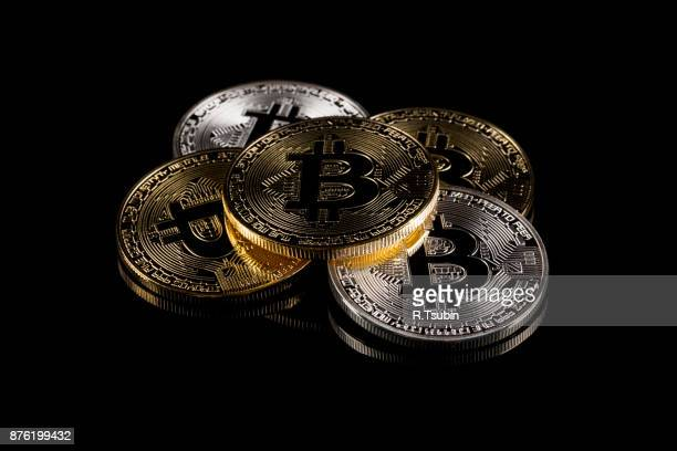 physical version of bitcoin coin - bitcoin stock photos and pictures