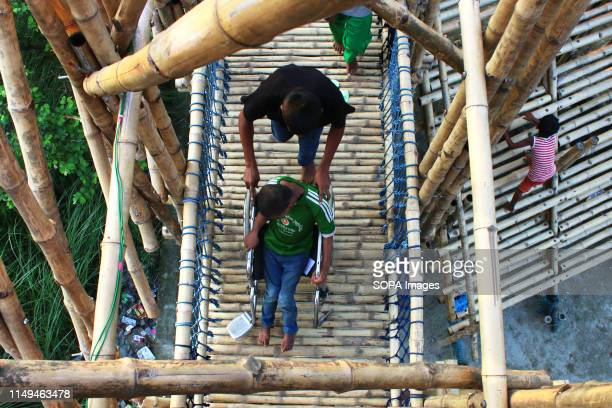 A physically challenged boy enjoying his moment inside the bamboo play space in Dhaka The unique play space built in Dhaka has brought smiles on the...