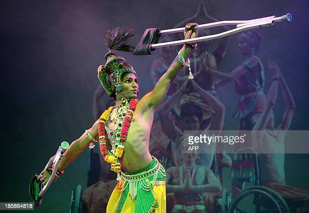 A physically challenged dancer of the Ability Unlimited Foundation performs 'Bharatanatyam' with crutches a classical Indian dance at an event in...