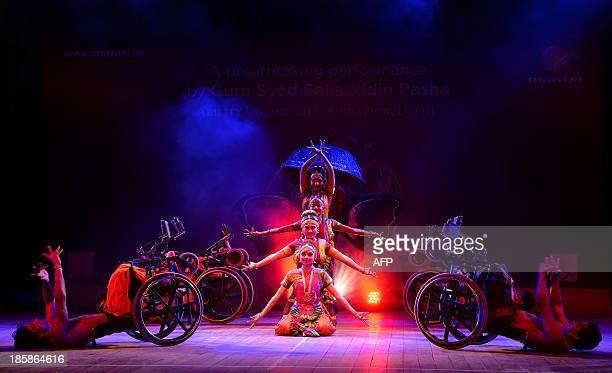 Physically challenged dancers of the Ability Unlimited Foundation perform 'Bharatanatyam' on wheelchairs a classical Indian dance at an event in...