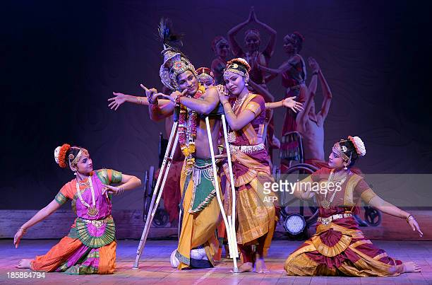 Physically challenged dancers of the Ability Unlimited Foundation perform 'Bharatanatyam' with crutches a classical Indian dance at an event in...