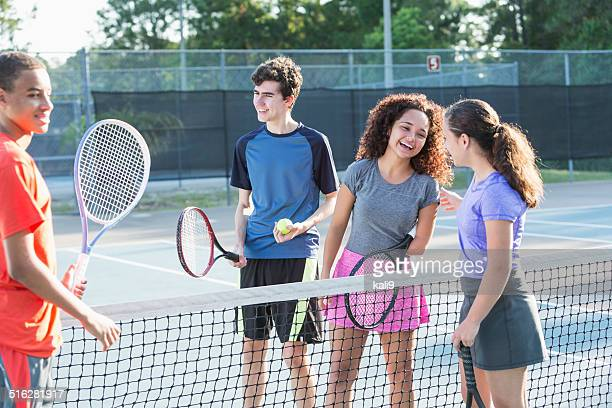 physically challenged teenage girl playing tennis - doubles stock photos and pictures