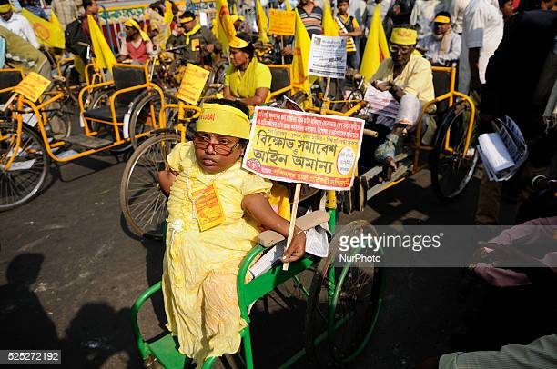 Physically challenged woman on a handicapped tricycle during the occasion of World Disability Day in Kolkata, India.