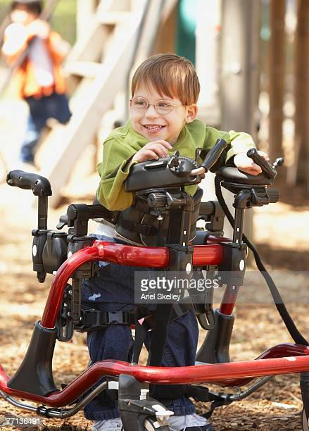 physically disabled boy at playground - assistive technology stock photos and pictures
