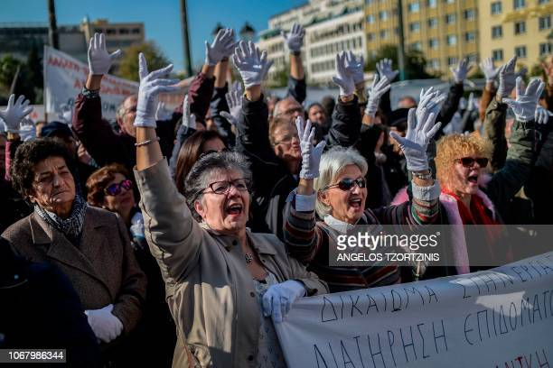 Physically disabled protesters and supporters take part in a demonstration marking the International Day of Persons with Disabilities in Athens on...