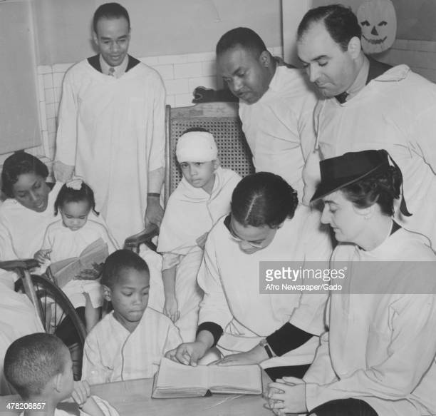 Physically handicapped children receive schooling at Freedmen's Hospital, Washington DC, 1935. Pictured are, from left, James Moore, John Pinkney,...
