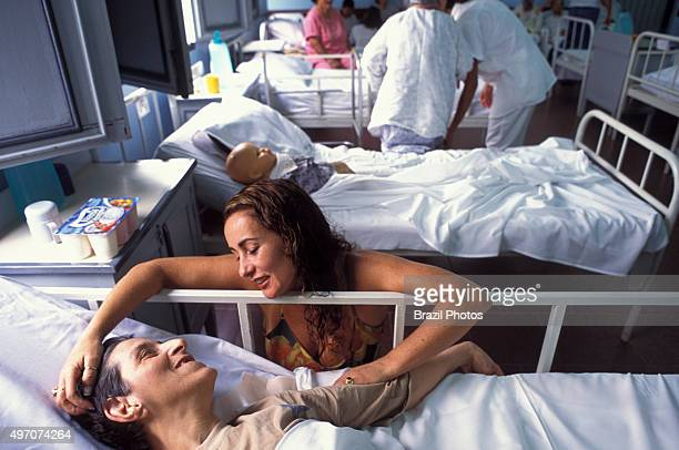 Physically impaired patients are cared by volunteers in Hospital that takes in chronically paralyzed patients or those totally dependent on bedside...