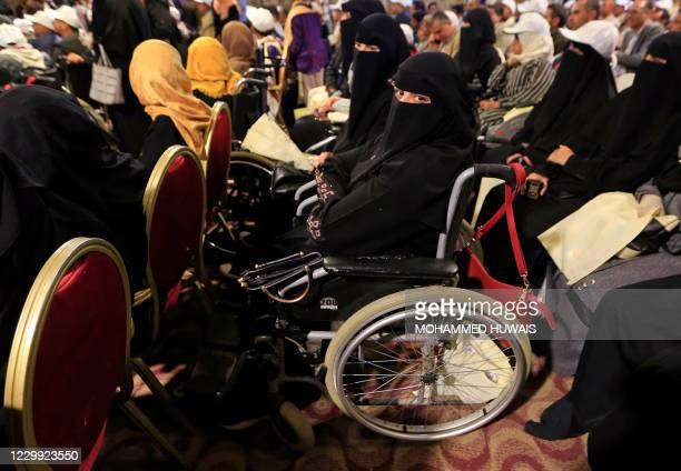 Physically-challenged Yemeni women attend a ceremony marking the International Day of Persons with Disabilities in the capital Sanaa, on December 3,...