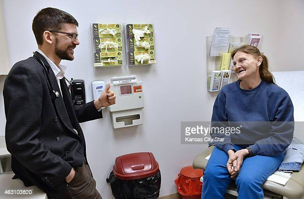 Physician Blair Thedinger gives Lesia McWilliams a thumbs up during her visit on Tuesday Jan 20 as he tells her the hepatitis C virus was...