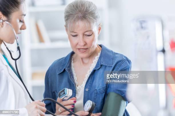 Physician checks patient's oxygen level