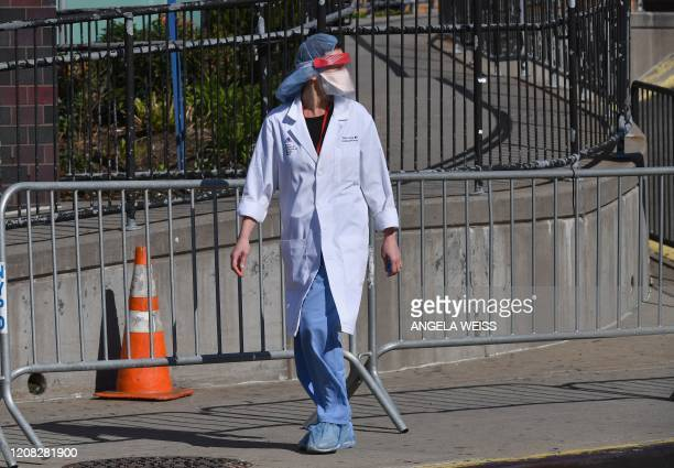 A physician is seen outside at Elmhurst Hospital Center in the Queens borough of New York City on March 26 2020 Elmhurst reported 13 COVID19 patients...