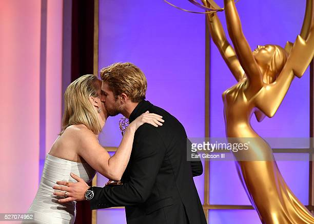 Physician Jennifer Ashton presents Actor Bryan Craig an Emmy for Outstanding Younger Actor in A Drama Series on stage at the 43rd Annual Daytime Emmy...