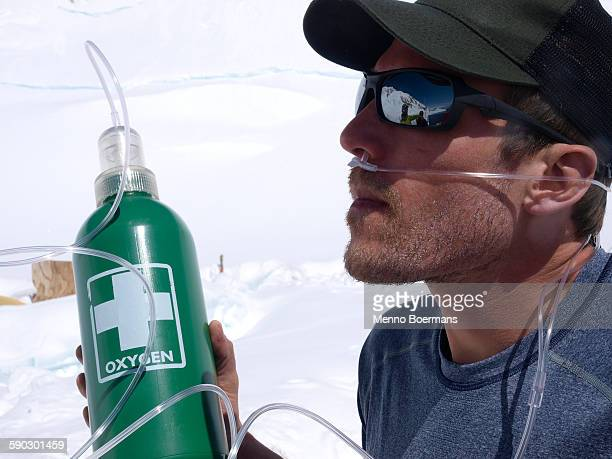 Physician of Denali Rescue is testing an emergency oxygen system, high on Mt. McKinley. With this system patients can be administered low concentration of oxygen, that will help them recover from altitude sickness.