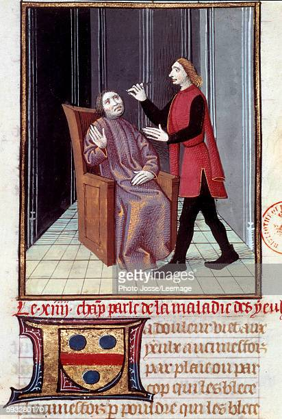 A physician performing surgery on the eye of his patient Miniature from 'The History of Medicine' 16th century BN Paris France