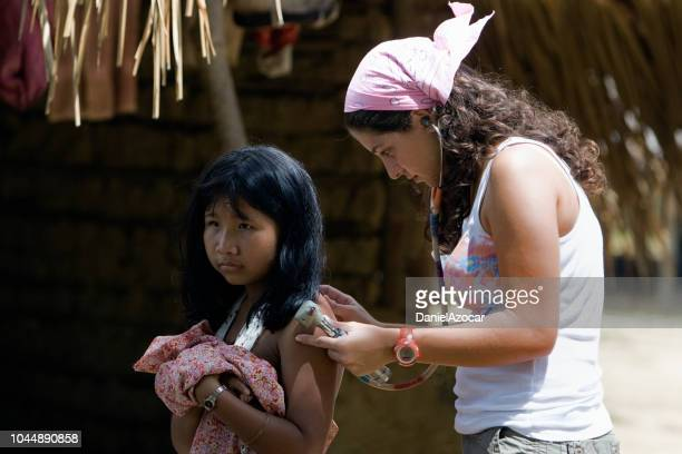 physician providing humanitarian help in remote regions - venezuela stock pictures, royalty-free photos & images