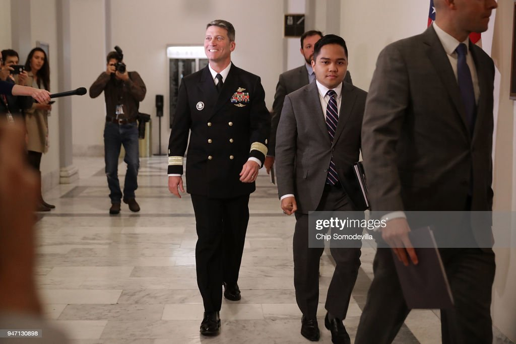 Physician to the President U.S. Navy Rear Admiral Ronny Jackson (C) arrives for a meeting with Senate Veterans Affairs Committee Chairman Johnny Isakson (R-GA) in the Russell Senate Office Building on Capitol Hill April 16, 2018 in Washington, DC. President Donald Trump nominated Jackson, his personal doctor at the White House, to be the new Secretary of the Department of Veterans Affairs after Trump fired David Shulkin on March 28.
