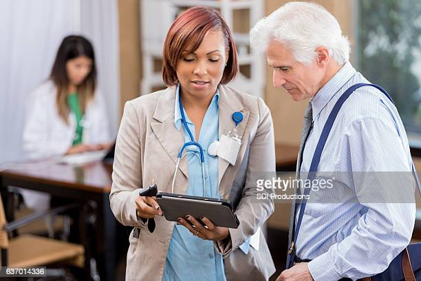 Physician uses a digital medical record to discuss patient diagnosis