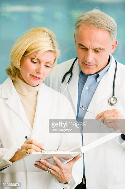Physicians Discussing a Medical Chart