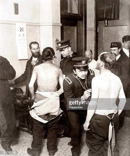 Physicians examining a group of Jewish immigrants at Ellis Island, New York City USA, circa April 1907. This was an historic month in American...