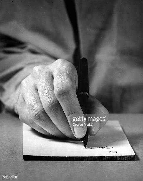 physician's hand writing prescription - 20th century stock pictures, royalty-free photos & images