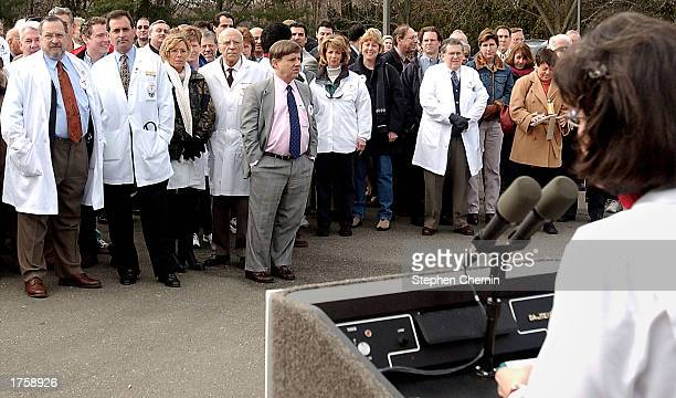 Physicians listen to Dr Ruth Schulze President of the Bergen County medical Society during a brief rally protesting skyrocketing malpractice...