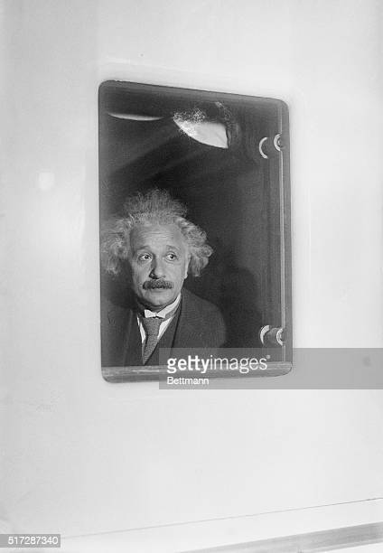 Physicist Albert Einstein in a window on SS Belgenland upon arrival at Pier 59 in New York City