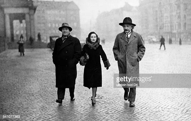 ' Physicist Albert Einstein with his daughter Margot and Russian author Dimitrij Marianoff on the way to their wedding at the city hall in Berlin...