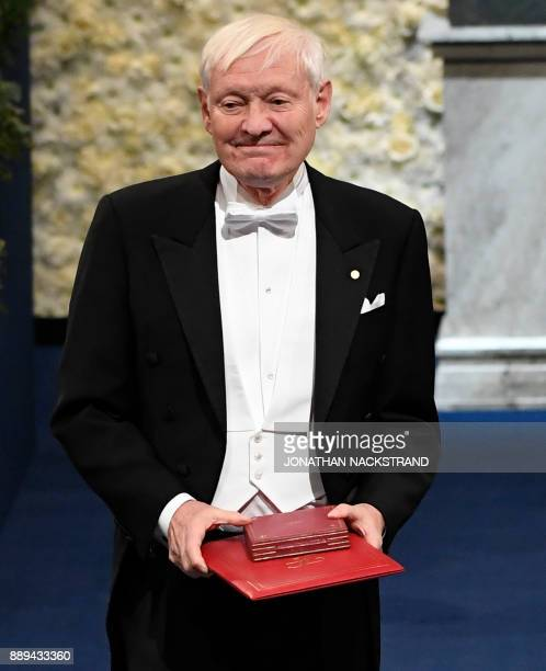 US physicist and Nobel Prize in Chemistry 2017 laureate Joachim Frank poses after being awarded during the Nobel Prize Award Ceremony at the...