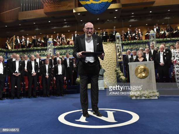 US physicist and Nobel Prize in Physics 2017 laureate Kip S Thorne acknowledges applause after being awarded during the Nobel award cermony at the...