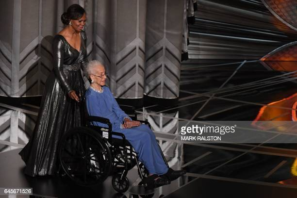NASA physicist Katherine Johnson arrives on stage to present the Best Documentary Feature award at the 89th Oscars on February 26 2017 in Hollywood...