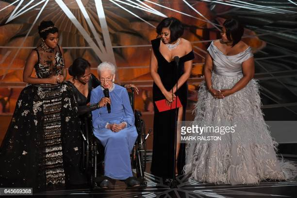 NASA physicist Katherine Johnson is surrounded by US singer and actress Janelle Monae US actress Taraji P Henson and US actress Octavia Spencer as...