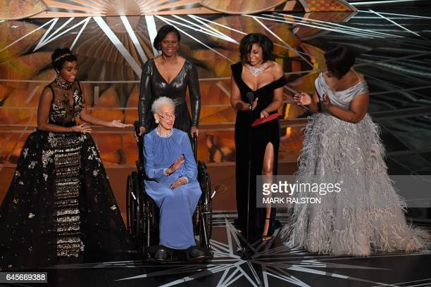 TOPSHOT NASA physicist Katherine Johnson is surrounded by US singer and actress Janelle Monae US actress Taraji P Henson and US actress Octavia...
