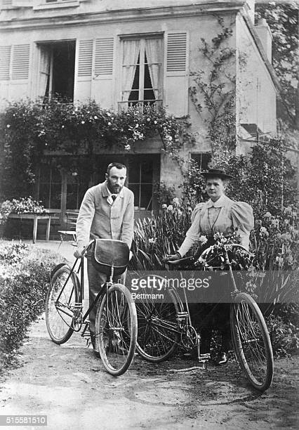 Physicist Pierre Curie and his wife chemist Marie Curie go for a bicycle ride