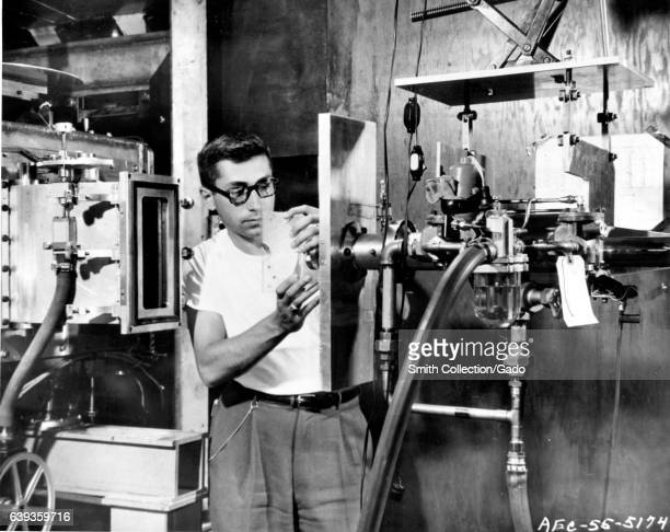 Physicist prepares a piece of plastic that will be bombarded with billion volt protons in the Cosmotron at Brookhaven National Laboratory, Upton, New...