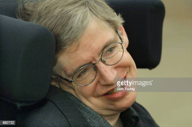 Physicist Stephen Hawking smiles at a symposium to honor his birthday at the Center for Mathematical Sciences at the University of Cambridge January...