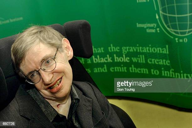 Physicist Stephen Hawking smiles during a symposium in honor of his birthday at the University of Cambridge January 11 2002 in Cambridge England...