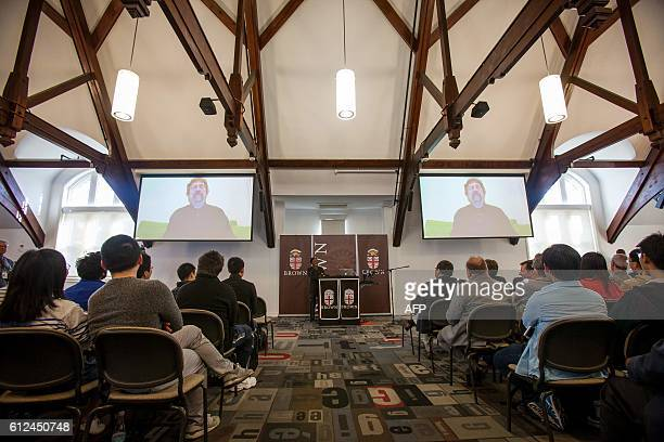 Physics professor J Michael Kosterlitz speaks with Brown University facutly and students via video chat from Finland following news he's won the...
