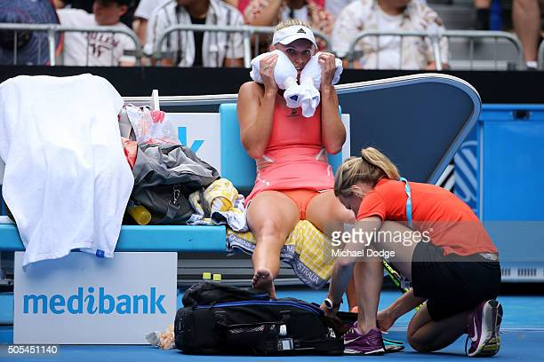 A physio attends to Caroline Wozniacki of Denmark in her first round match against Yulia Putintseva of Kazakhstan during day one of the 2016...