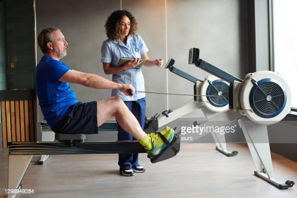physio rehab programme - exercising stock pictures, royalty-free photos & images