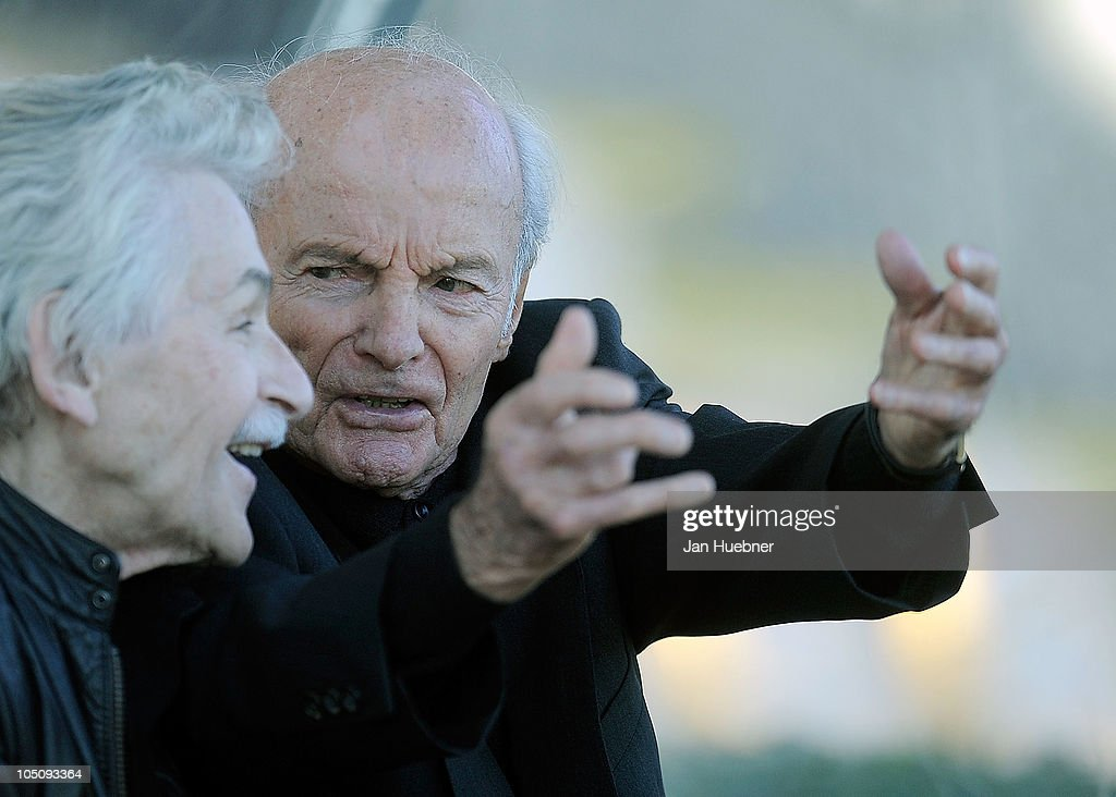 DFB physiotherapist Adolf Katzenmeier and head coach Dettmar Cramer of Germany talk during the DFB Writers League match between Germany and Argentina on October 8, 2010 in Frankfurt am Main, Germany.