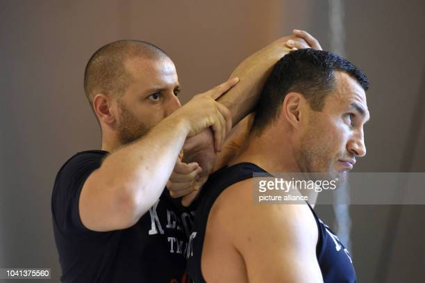 Physiotherapist Aldo Vetere treats professional boxer Wladimir Klitschko during a traning session in Going Austria 19 August 2014 IBF IBO WBOand...