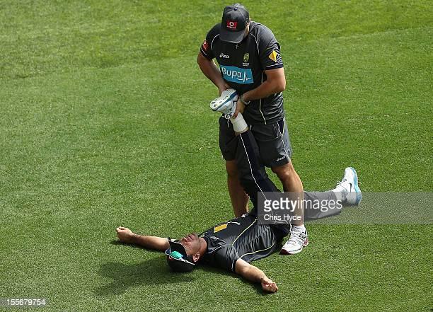 Physiotherapist Alex Kountouris stretches Ricky Ponting during an Australian nets session at The Gabba on November 7 2012 in Brisbane Australia