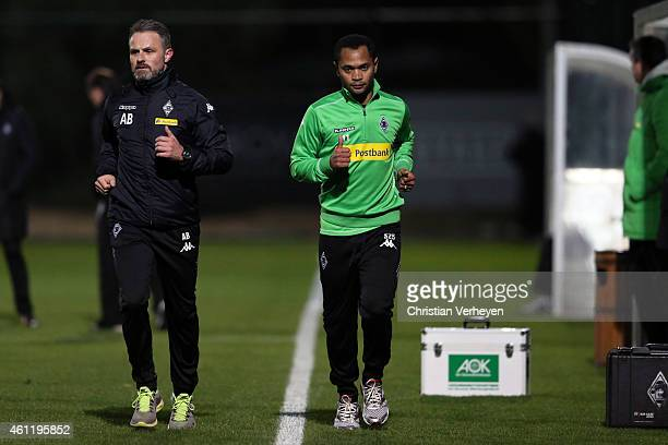 Physiotherapist Andreas Bluhm of Borussia Moenchengladbach and Raffael of Borussia Moenchengladbach during a training session at day one of Borussia...