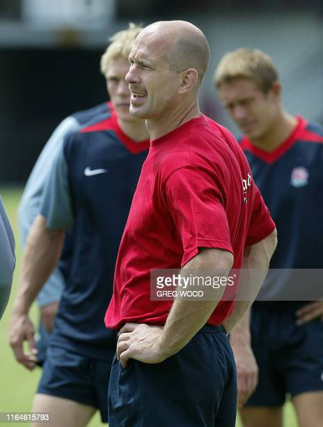 Physiotherapist Philip Pask takes England's World Cup rugby team through their warmups in the absence of regular fitness coach David Reddin during...