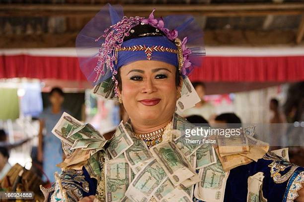 Phyu Lay a medium covered with money offered by attendants dances in a shrine dedicated to the nats during the Taungbyon festival Every year in...