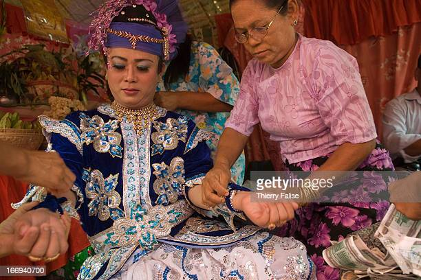 Phyu Lay a medium is getting dressed before dancing at the Taungbyon nat festival Every year in August hundreds of thousands of people from all over...