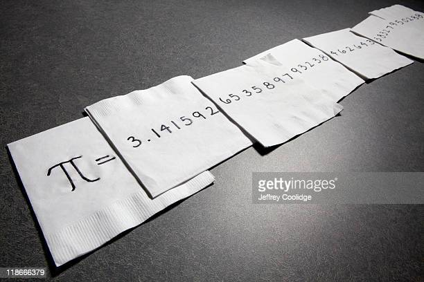 pi on napkins - symbol stock photos and pictures