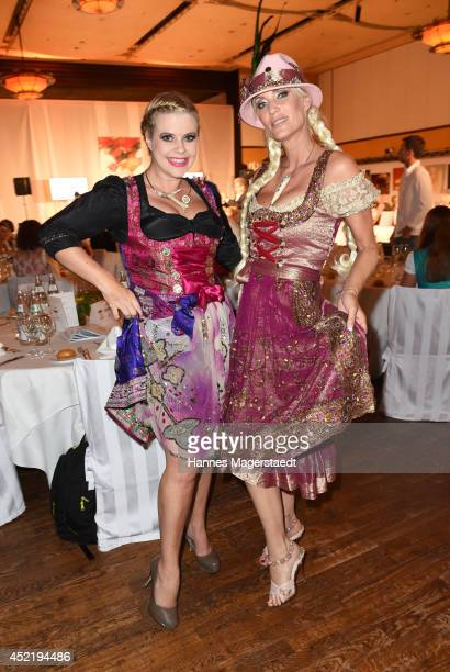 Pia Bolte and Sarah Kern attend the Sixt ladies dirndl dinner on July 15 2014 in Munich Germany