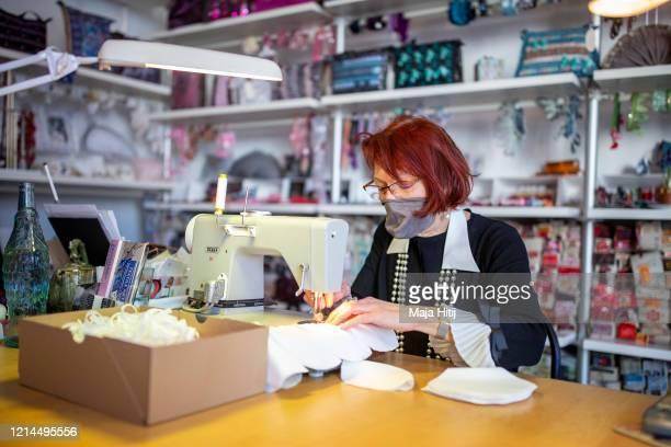 Pia Fischer a Berlin fashion designer sews protective masks against the corona virus at her workshop in Schöneberg district on March 24 2020 in...